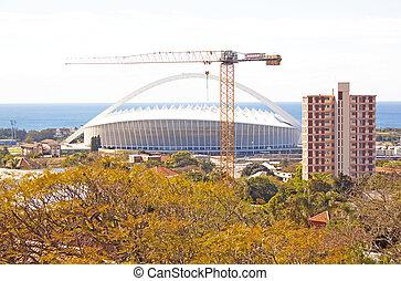 Moses Mabhida Stadium with construction crane in foreground
