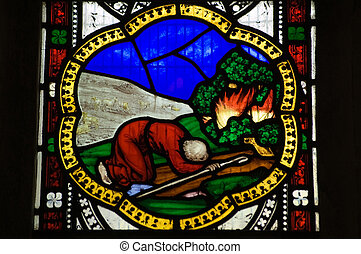 Victorian stained glass window showing Moses and the burning bush. window over 100 years old, on public display.