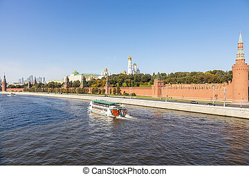 Moskva river with boat near Kremlin in Moscow