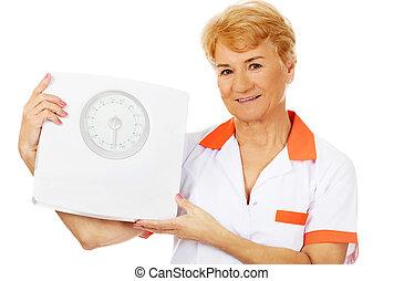 mosoly, öregedő, doktornő, vagy, ápoló, fog, weigh salak