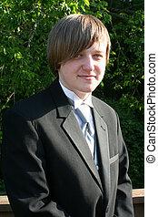 mosolygós, tizenéves fiú, alatt, black szmoking, függőleges