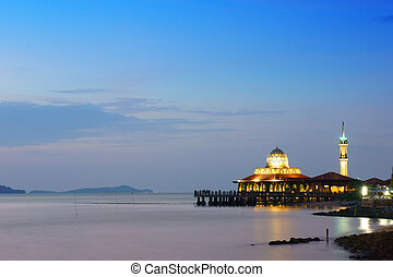 mosque at twilight time near sea