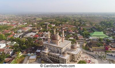 mosque in indonesia - beautiful mosque with minarets on ...
