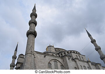 Mosque minarets in Istanbul with blue sky and clouds