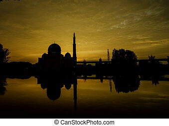 mosque silhouette and reflection on the lake