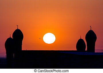 mosque silhouette at dawn sun