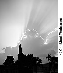 Mosque with minaret and rays of light - Silhouette of mosque...