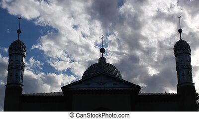Mosque.2 - Time lapse clouds flowing past twin minaret ...
