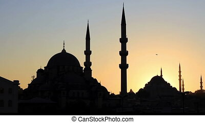 Mosques against sunset. Pan video - Mosques against sunset....