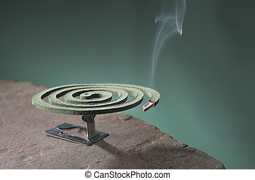 Mosquito coil is mosquito-repelling incense, usually shaped...