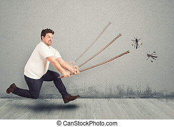 Angry Man strikes with the stick big mosquitoes