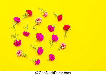 Moss-rose on yellow background. Top view