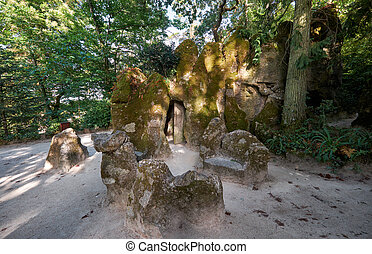 Mossy stones hiding the entrance to Initiation Well in...