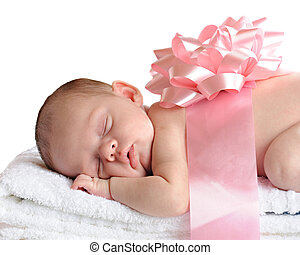 A beautiful newborn sleeping on a stack of white towels. She's wrapped with a broad pink ribbon and bow. Isolated on white.