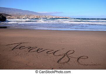 mot écrit, sable