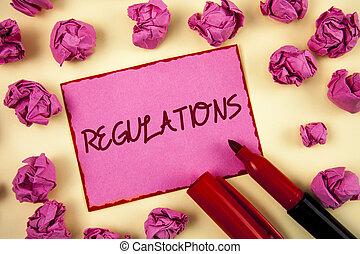mot, écriture, texte, regulations., concept affaires, pour, règles, lois, constitué, normes, policies, sécurité, déclarations, écrit, sur, rose, note collante, papier, sur, uni, fond, boules papier, et, marker.