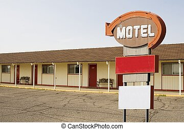 A motel with a motel sign in front. These are available as separate objects in other images.