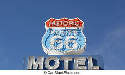 Motel retro sign on historic route 66 famous travel destination, vintage symbol of road trip in USA. Iconic lodging signboard in Arizona desert. Old-fashioned neon signage. Classic tourist landmark