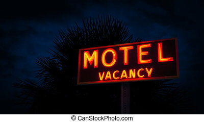 Motel Sign By Tropical Plant At Night - Neon motel sign next...