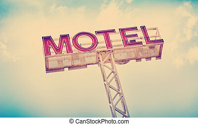 Motel Sign - Classic motel sign against blue sky