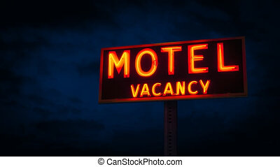 Motel Sign Lit Up At Night - Neon motel sign in the dark