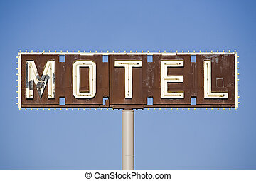motel sign - old sign in disrepair against blue sky
