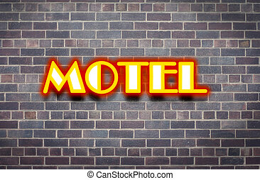 Motel signage lit with neon lights in a concrete tile ...
