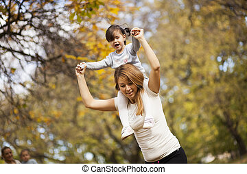 Mother an daughter in the autumn park