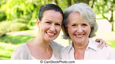 Mother and adult daughter smiling
