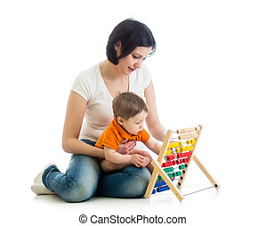 mother and baby boy play with counter toy