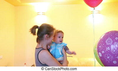 Mother and Baby Boy playing with balloons, fast, loop