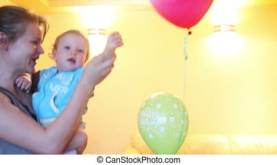 Mother and Baby Boy playing with balloons