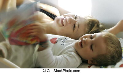 Mother and Baby Boy reading Stories