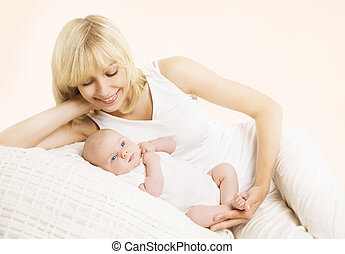 Mother and Baby, Happy Mom Embracing Newborn Kid, Woman looking to New Born Child