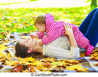mother and baby   in the autumn park