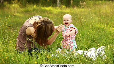 Mother and baby in the meadow - Family outdoors