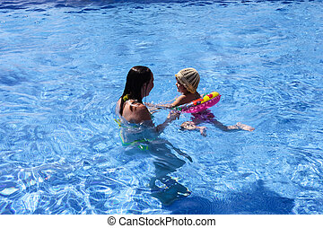 Mother and baby in the pool