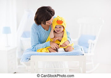 Mother and baby in towel after bath