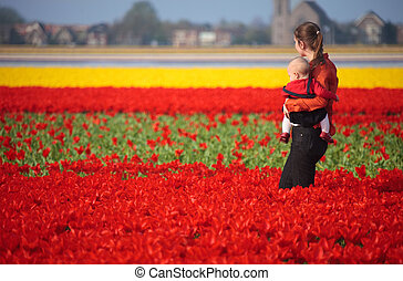 Mother and Baby in Tulip Field
