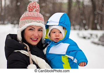 Mother and baby in winter park