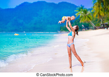 Mother and baby on tropical beach