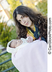 Mother and baby outdoors in park