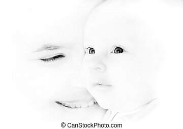 mother and baby portrait in high-key, focus on baby's eyes
