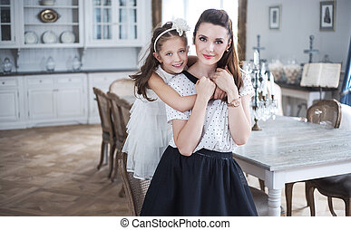 Mother and baby relaxing in a stylish interior
