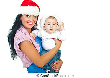 Mother and baby son with Santa hats
