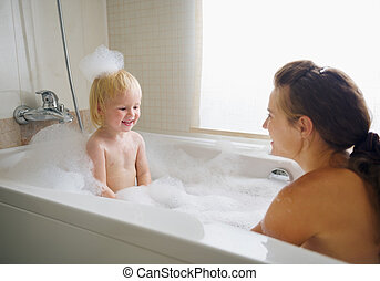 Mother and baby taking bath