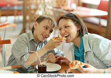 Mother and boy eating