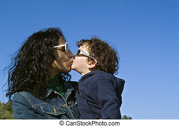 mother and boy kissing