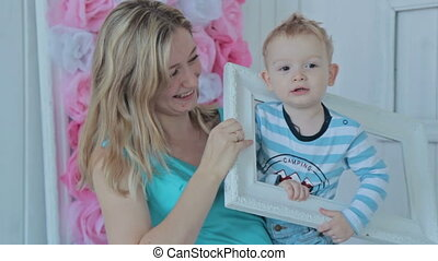 Mother and boy looking through a frame