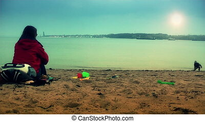 Mother and boy on the beach playing